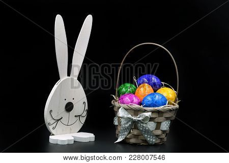 Easter Eggs In Basket With Rabbit On Black Background