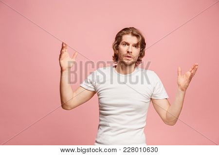 Argue, Arguing Concept. Beautiful Male Half-length Portrait Isolated On Pink Studio Backgroud. Young