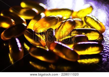 Cod Fish Liver Oil Pills In Black Background Rich In Vitamin A For Nutritional Supplement