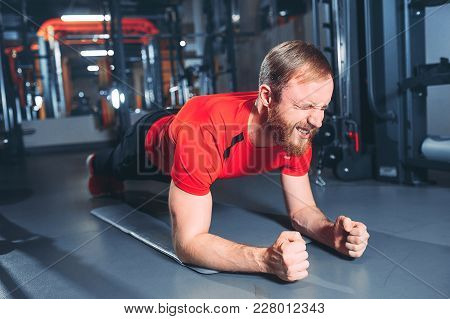 Yoga. Portrait Of Yogi Men Doing Yoga Exercise On Black Mat, He Breath And Performing Upward Abdomin