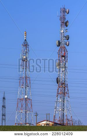 Towers With Communication Antennas With Receptors And Emitters.