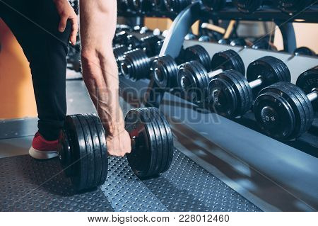 Dumbbell In The Hand Of The Athlete