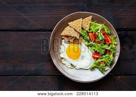 Healthy Vegetarian Breakfast Flat-lay. Breakfast Plate - Cracker, Arugula, Cherry Tomatoes And Fried