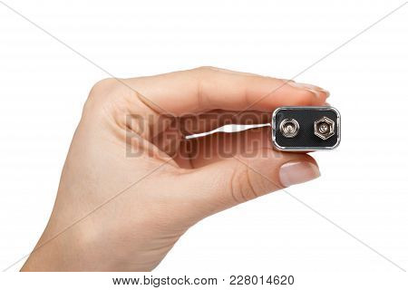 9V battery, nine volt power cell in hand. Isolated on white background. poster