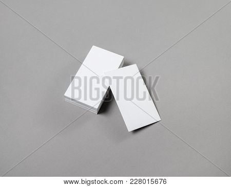 Blank Business Cards On Grey Paper Background.