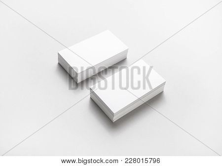 Two Horizontal Blank Business Cards Stacks On Paper Background.