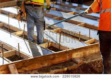 Construction Workers Are Pouring Concrete To Build Roads. Concrete Road Construction