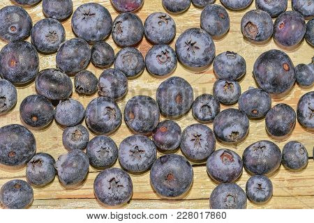 Blueberries  On White Wooden Background. Bilberries, Blueberries, Huckleberries, Whortleberries Flat