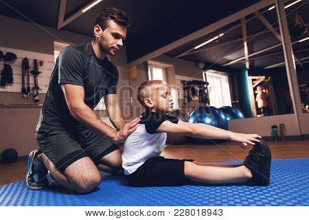 Father And Son In The Gym. Father And Son Spend Time Together And Lead A Healthy Lifestyle. Man And