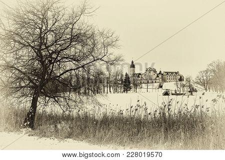 Belarusian Attraction Nesvizh Castle Covered With Snow In The Winter Season. Retro Style