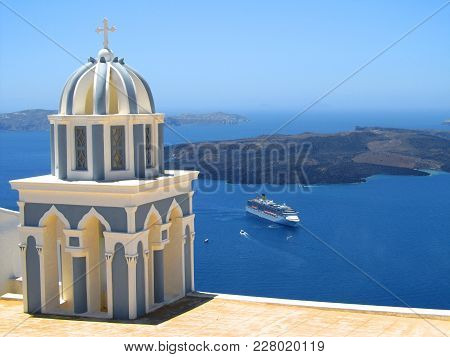 Belltower Of A Church With A View Of  Volcanic Caldera And Cruise Ship In It, Santorini, Cyclades, G