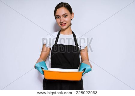 Beautiful Young Girl Chef In Black Apron Cooked A Delicious Pie