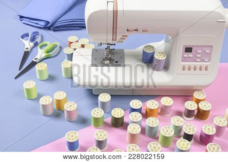 Sewing Machine And Colorful Thread Rolls For Sewing On Two Tone Background, Sewing And Needlework Co