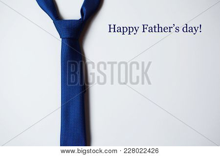 Bright Blue Tie On Light Blue Background. Happy Fathers Day Pattern For Greeting Card. Top View Imag