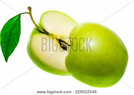 Two Halfs Of The Sliced Green Apple Isolated On A White Background.