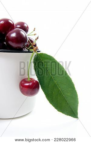 White Cup With Red Sweet Cherry Isolated On A White Background..