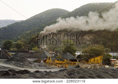 Coal Mining In The Mountains, The Mountains Are Covered With Green Trees, Smoke Is Coming
