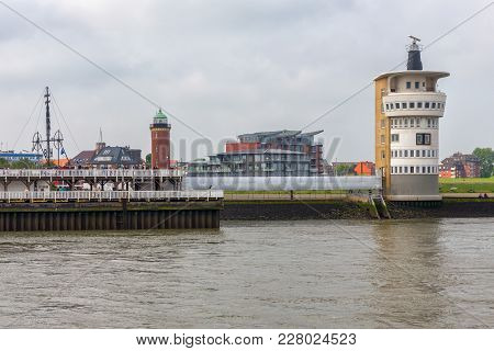 Cuxhaven, Germany - May 19, 2017: German Harbor Cuxhaven With Old Lighthouse And Radar Tower For Ass