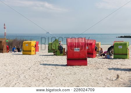 Helgoland, Germany - May 20, 2017: Seaside Visitors In Colorful Beach Chairs At Dune, German Island