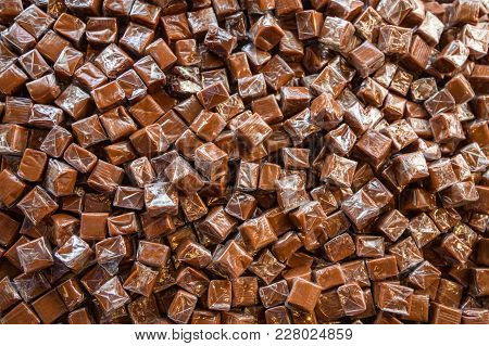 Toffee Candy Brown Background. Caramel Cubes Brown.