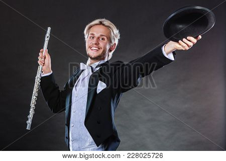 Classical Music, Passion And Hobby Concept. Elegantly Dressed Musician Man Holding Flute Wearing Bla