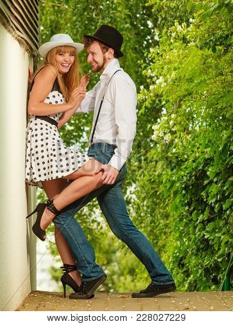Summer Holidays Love Relationship And Dating Concept - Romantic Playful Couple Retro Style Flirting