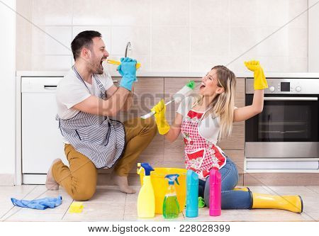 Man And Woman Singing After Finishing Chores