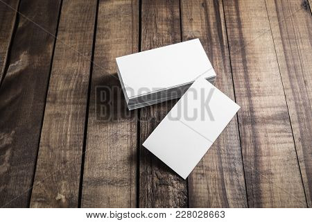Photo Of Blank Business Cards On Wood Table Background. For Design Presentations And Portfolios. Top