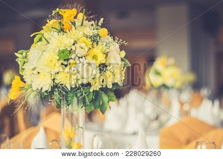 Colorful Bouquet Of Field Flowers In The Glass Vase, Close Up. Restaurant Table Decoration Or Settin