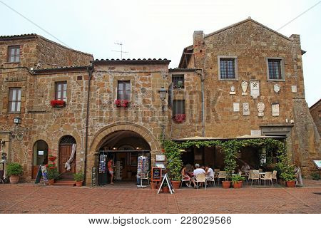 Sovana, Italy - July 26, 2017: Tourists On Central Square Of Sovana, A Medieval Village In Grosseto