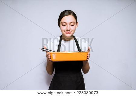 Beautiful Young Woman Cook In A Black Apron Preparing A Delicious Cake, Enjoying The Aroma