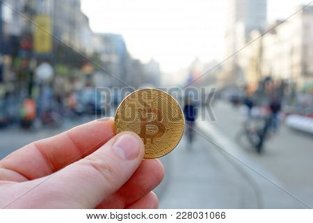 Bitcoin Payment In A Shopping Street Or Store Using Cryptocurrency In Real Life Concept