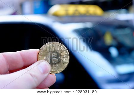 Bitcoin Payment A Taxi For A Fare Using Cryptocurrency In Real Life Concept