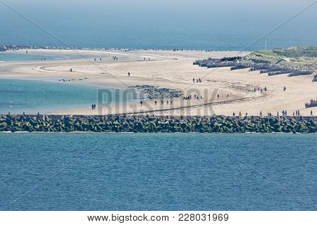 Aerial View German Island Dune In The Northsea Opposite Of Helgoland. People Are Photographing Seals