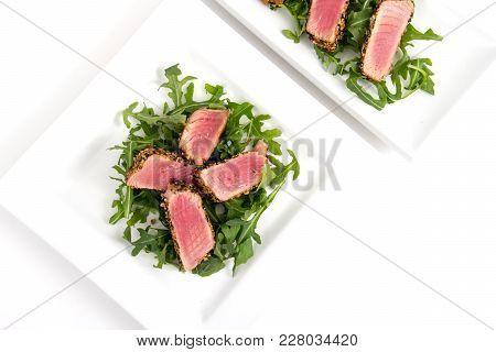 Tuna Tataki Sesame Crust Appetizer Plate Over White Background