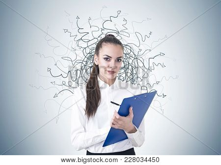 Beautiful Young Businesswoman Wearing A White Shirt, A Skirt And A Dark Lipstick Writing On A Blue C