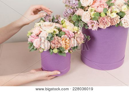 Perfect Gift Or Compliment. Bouquet In Green Hatbox. Beautiful Luxury Bunch Of Mixed Flowers In Woma