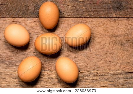 Easter Background With Brown Organic Eggs Arranged On Rustic Wooden Table