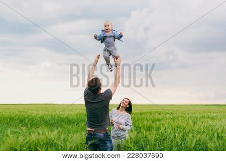Joyful Fun Man, Woman Walking On Nature Background Hugging, Playing With Little Cute Child Baby Boy.