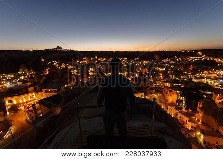 Night Goreme Landscape Of Cappadocia. Man On Top Of A Mountain Of Goreme. Man Is Watching At Cappado