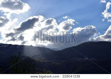 Mountain Landscape With Mosque. Sunlight From Behind Clouds. Macedonia