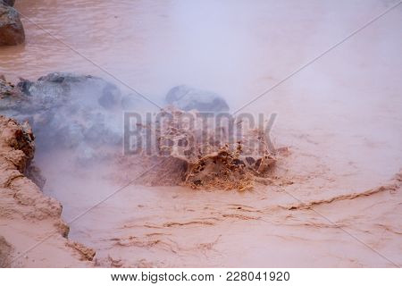 Splashing Mud In Hot Pots At Fountain Paint Pots In Yellowstone National Park