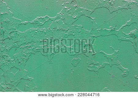 Old Green Metallic Background With Peeling And Cracked Paint. Seamless Texture.