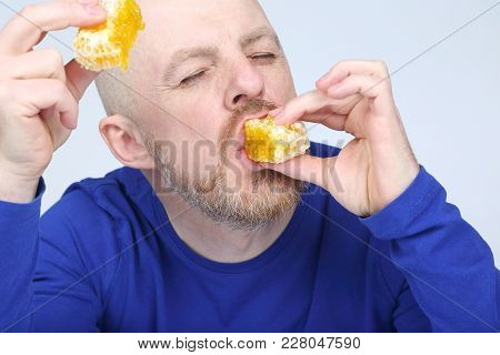 The A Man Is Appetizing Eats Honey
