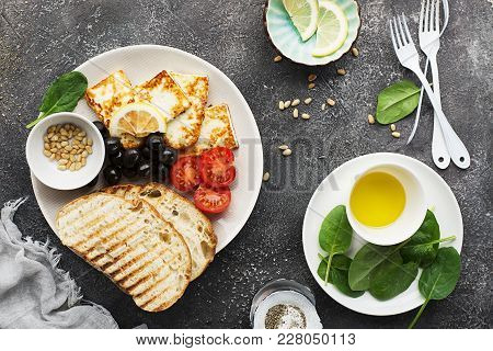 Appetizing Snack With Fried Cheese Haloumi, Olives, Bruschetta, Tomatoes, Olives, Pine Nuts, Prosciu