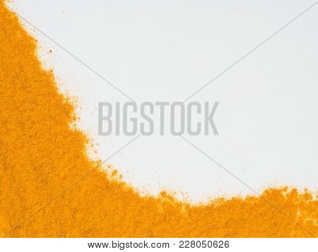 Turmeric Powder Or Curcuma Longa On White Background. Top View. Copy Space For Text.
