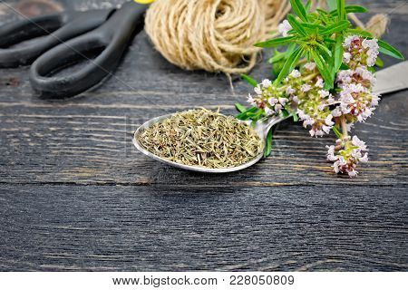 Thyme Dry In A Metal Spoon, A Bunch Of Fresh Herbs With Flowers, A Skein Of Twine And Scissors On Th