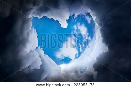 Heart Shape With Blue Sky In The Dramatic And Storm Clouds