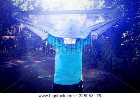 Toned Photo Of Teenager In Hoodie Standing Outdoor