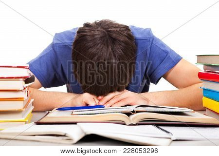 Tired Student Sleep On The Book On The White Background